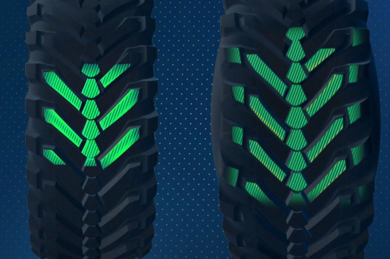 中央に背骨のようにある溝が公道での直進安定性に貢献、畑で空気圧を下げるとショルダー部も路面に接地し通常のハの字タイヤのようになる