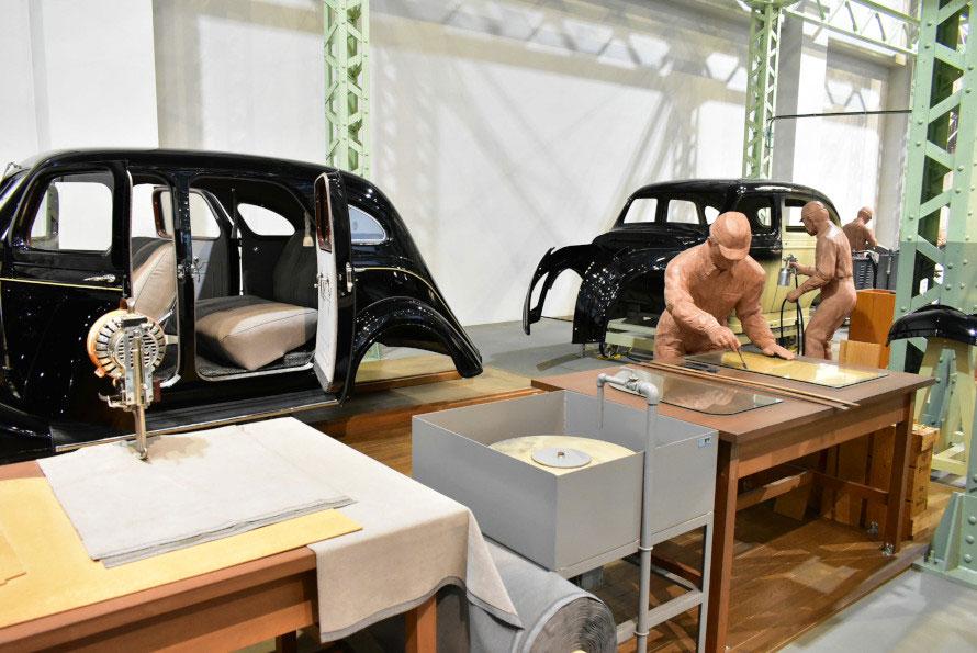 ボディ鋼板の裁断から溶接、そして組立まで手作業中心で行われている様子が見られる