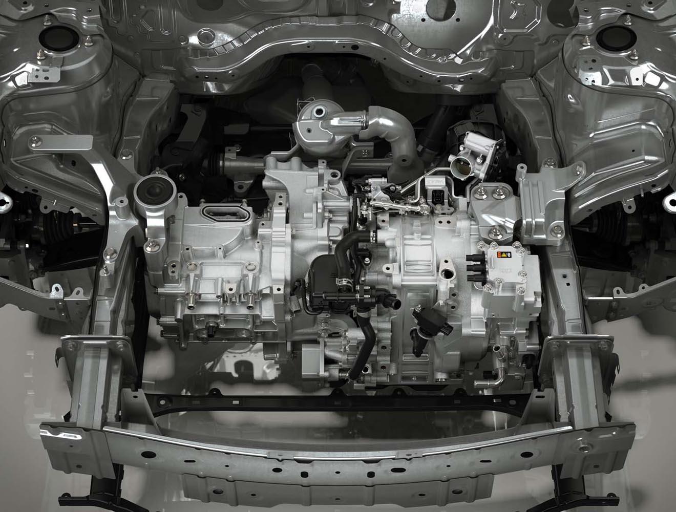 マツダは、軽量なロータリーエンジンを使ったレンジエクステンダー(写真中央)の開発も進めている。燃料を使って電気を作り出し、その電力でモーターを駆動するもので、プラグインハイブリッドをはじめとするさまざまな電動化車両での活用が検討されている。