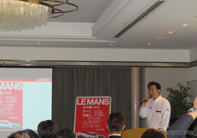 キービジュアルと標語、無料Webライブ等について説明するトヨタの北澤氏。
